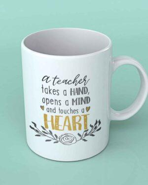 A teacher takes a hand coffee mug